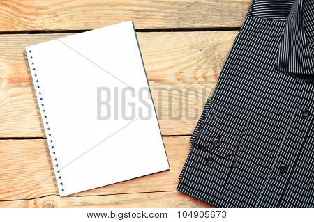 Shirt And Notepad On A Wooden Table