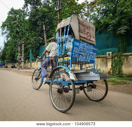 Indian Trishaw Driver Running On The Street