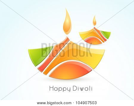 Colourful creative illuminated lit lamps on glossy background for Indian Festival of Lights, Happy Diwali celebration.