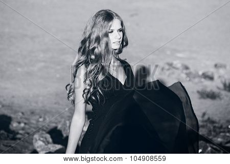 young beautiful girl portrait with the effect of black and white toning