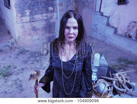 Priestess Near Pagan Altar