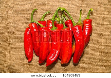 Many Ripe Red Peppers On A Old Cloth