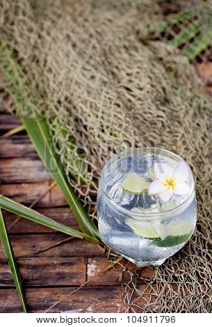 Gin tonic in glass with  ice cubes and lime slice