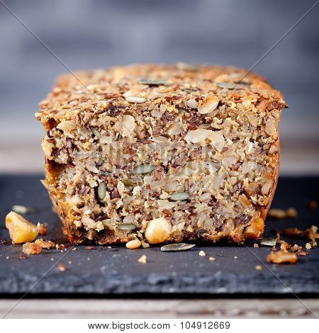 Wholegrain bread with seeds on a stone plate