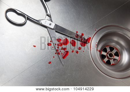 blood and scissors in the sink