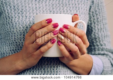 Woman In The Gray Sweater Holding In Her Hands With A Bright Nail Polish Large White Cup