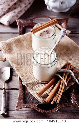 Baked milk yogurt with cinnamon in glass jars
