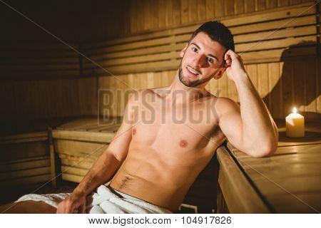 Man sitting inside a sauna at the spa