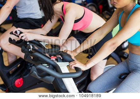 Fit people in a spin class at the gym