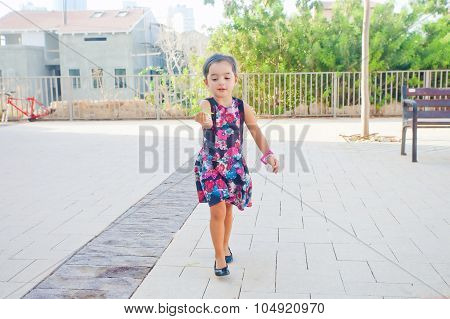 Cute Little Girl Carrying Leaves
