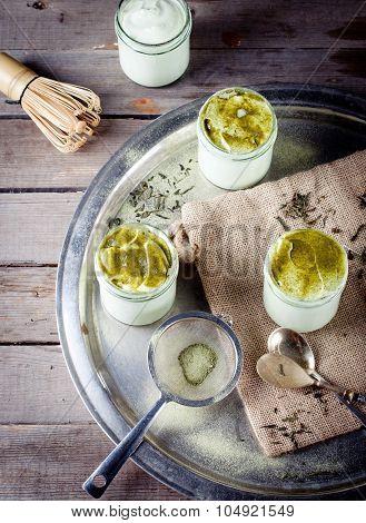 Green tea matcha yogurt, dessert in glass jars