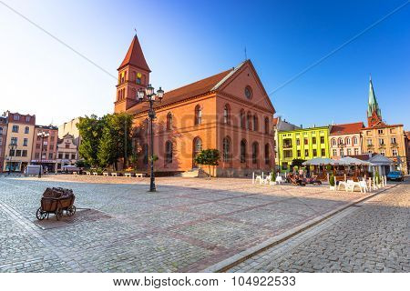TORUN, POLAND - AUG 9, 2015: Architecture of historical Trinity church in Torun, Poland. Torun is one of the oldest cities in Poland and the birthplace of the astronomer Nicolaus Copernicus.
