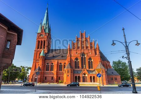 TORUN, POLAND - AUG 9, 2015: Architecture of historical St. Catherines church in Torun, Poland. Torun is one of the oldest cities in Poland and the birthplace of the astronomer Nicolaus Copernicus.