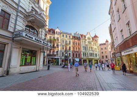 TORUN, POLAND - AUG 9, 2015: Unidentified people walking on the old town of Torun, Poland. Torun is one of the oldest cities in Poland and the birthplace of the astronomer Nicolaus Copernicus.