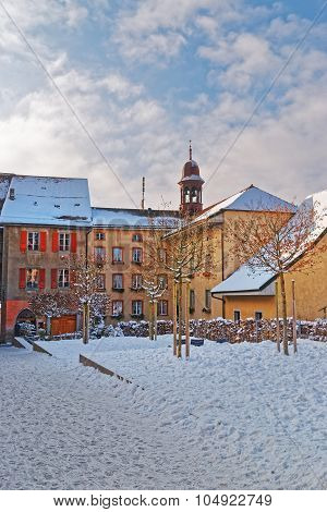 Beautiful Medieval Buildings Of The Town Of Gruyeres Covered With Snow