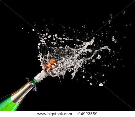 closeup of popping champagne and splash