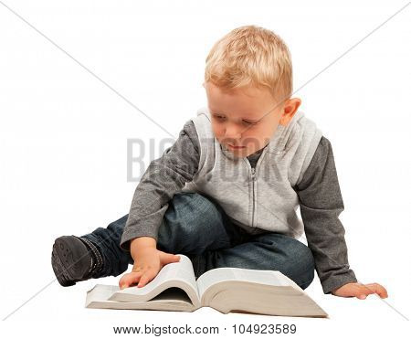 little child try to reading a book