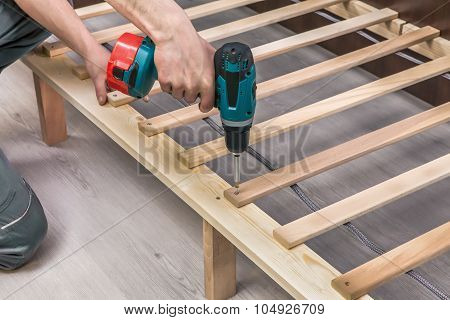 Wooden Furniture Assembling- Woodworker Screwing Screws Using A Cordless