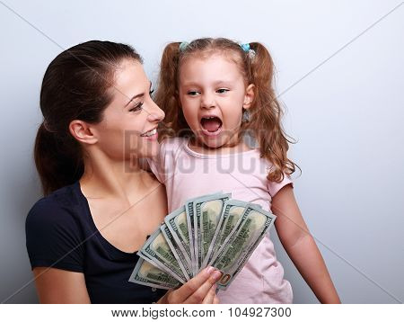 Happy Smiling Family Holding Dollars And Thinking How To Spend The Money