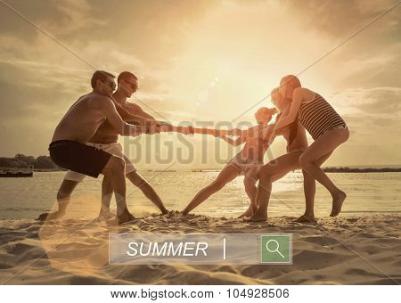 Friends funny tug of war on the beach under sunset sunlight.
