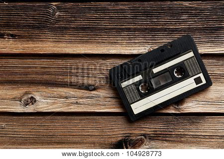 Audio Tape Cassette On Brown Wooden Background