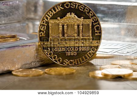 Austria Gold Philharmonic Coin With Silver Bars In Background
