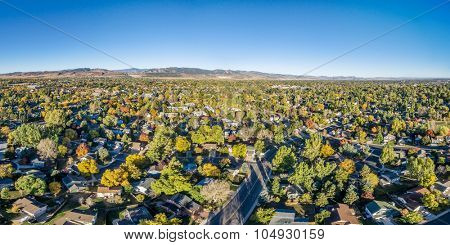 aerial panorama of Fort Collins in northern Colorado - residential buildings with Rocky Mountains foothills in background