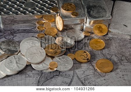 Gold Eagle & Silver Eagle Coins With Silver Bars On Map