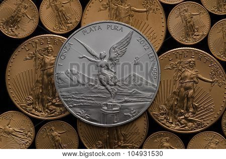 Mexican Silver Libertad Coin Over Tones Of American Gold Eagles