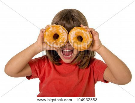 Happy Female Child Having Fun Playing With Two Sugar Donuts In The Eyes Smiling Excited