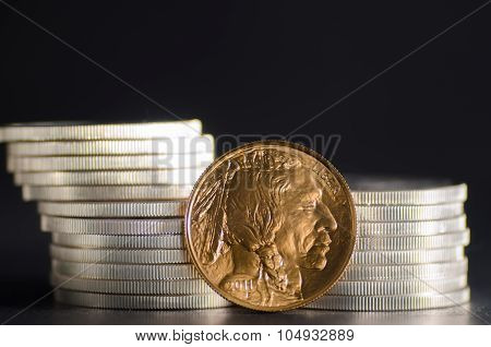 United States Gold Buffalo Infront Of Silver Coins