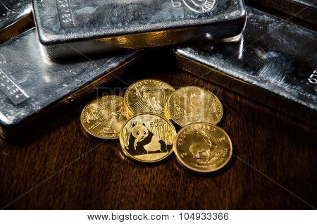 Vivid Gold Coins & Silver Bars On Wooden Table