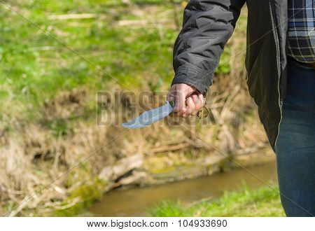 Man holding self-made knife