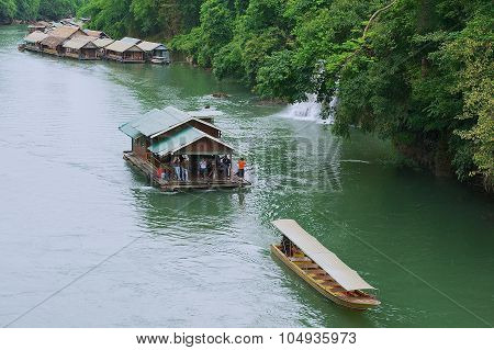 People take part in the river cruise in Suphan Buri, Thailand.
