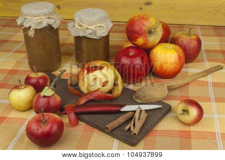 Domestic production of apple marmalade and cinnamon. Apple jam on the kitchen table