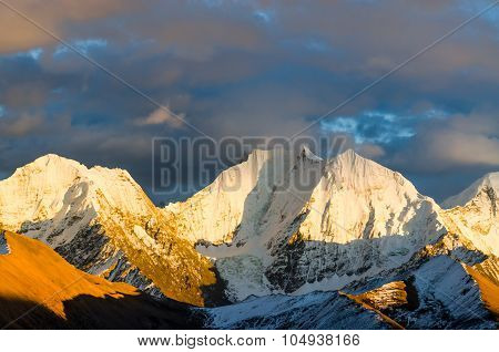 View From St. Moritz In Switzerland: High Snow And Ice Capped Alpine Mountain Range With Red Illumin