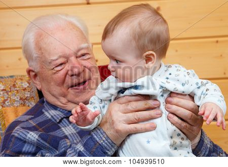 Very Old Man Holding Little Baby
