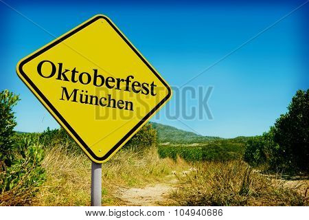 Oktoberfest munchen against yellow road sign by mountain trail