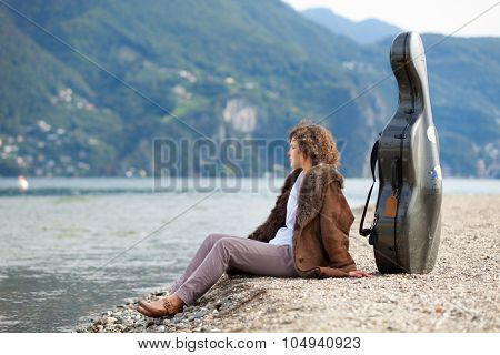 young musician on the seashore, portrait