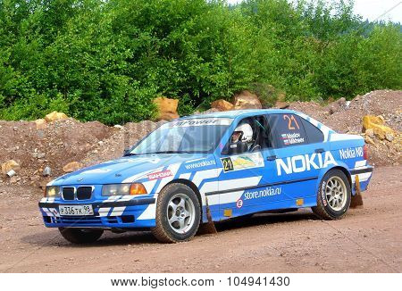 BAKAL, RUSSIA - JULY 9: Alexey Maslov's BMW 3-Series (No. 21) competes at the annual Rally Southern Ural on July 9, 2011 in Bakal, Satka district, Chelyabinsk region, Russia.
