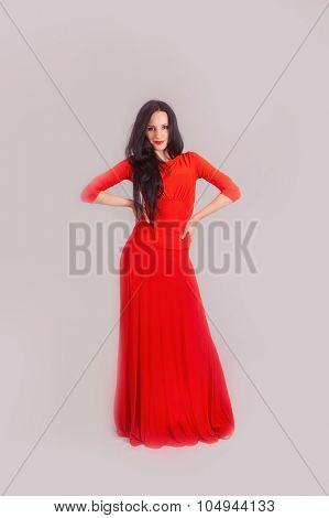 attractive women in red dress. studio shot