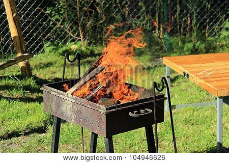 Fire Burns In The Grill