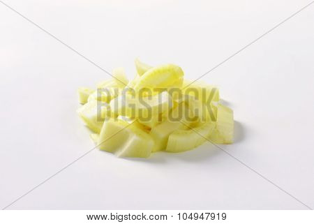 heap of sliced fennel bulbs on white background