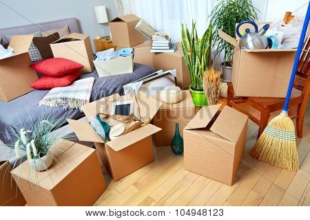 Moving boxes in new house. Real estate concept.