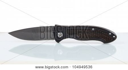 Cool Penknife On Glass Surface Isolated