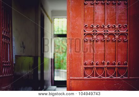 Red door detail with wrought iron ornaments