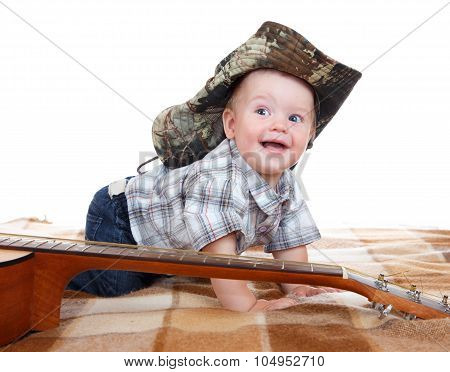 Happy Baby In Cowboy Hat And Acoustic Guitar