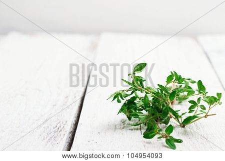 Fresh Herbs (thyme) On A Wooden Table