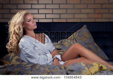 Attractive Beautiful Blonde Girl On Bed