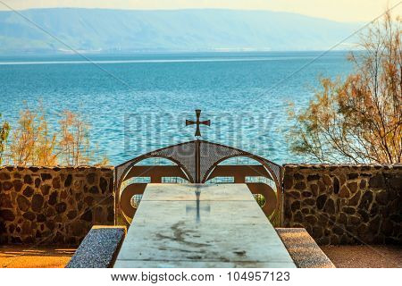 Table for pilgrims on the shore of Galilee. Park Orthodox Church